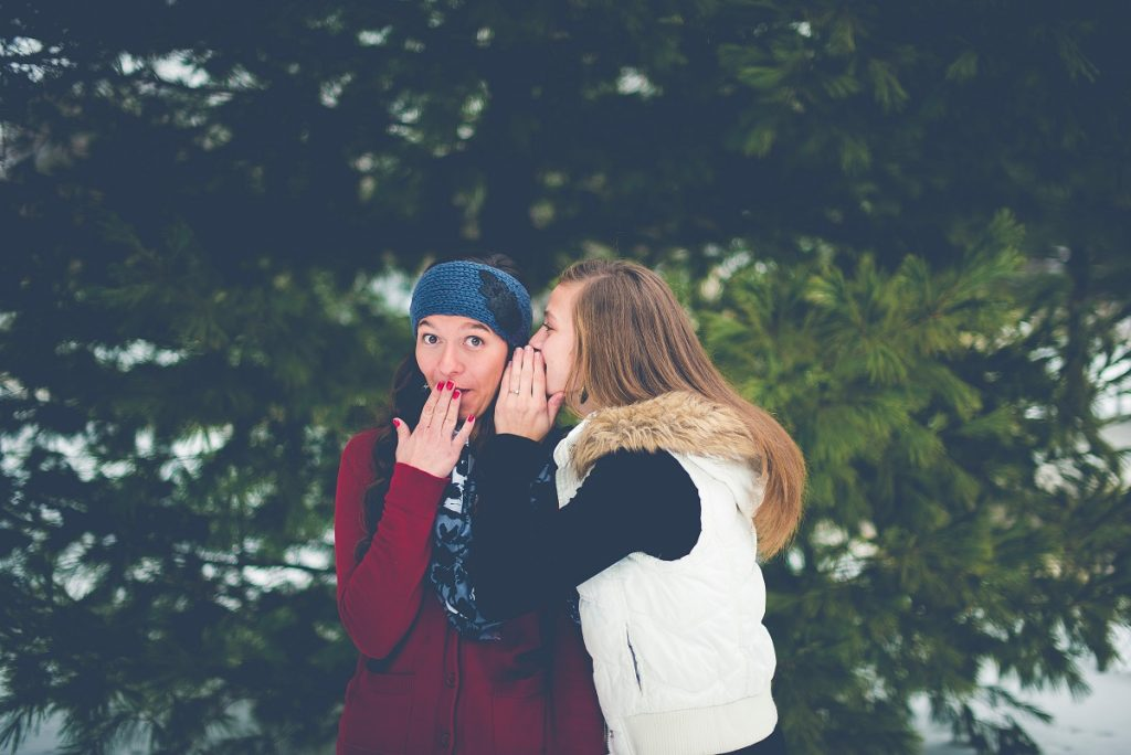 woman-telling-another-woman-a-secret