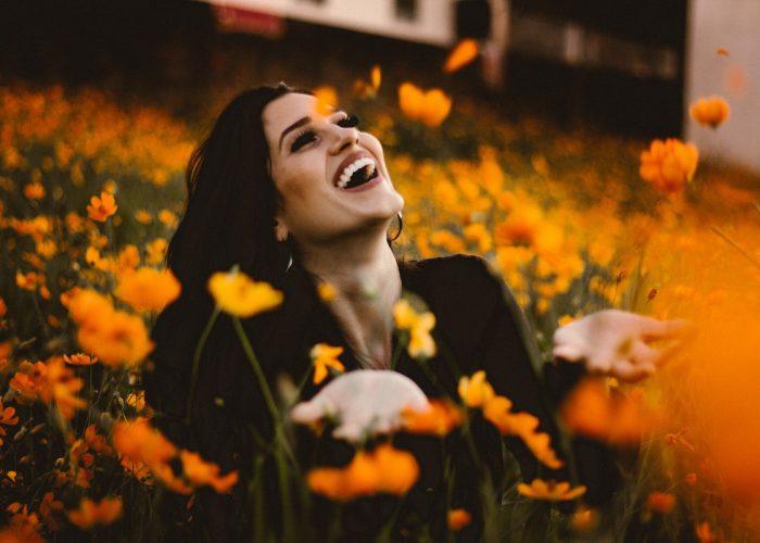 happy-woman-in-field-of-flowers