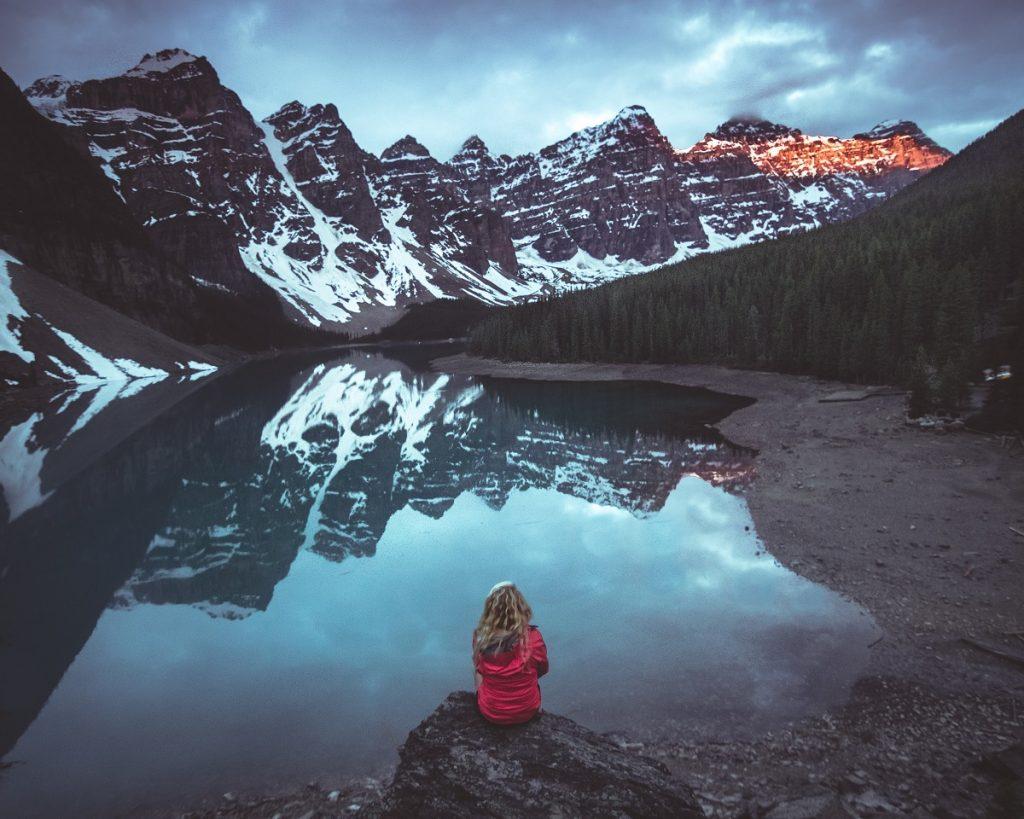 back-of-woman-alone-staring-at-lake