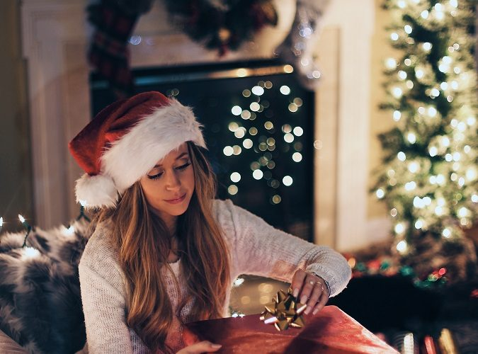 woman unwrapping present by herself