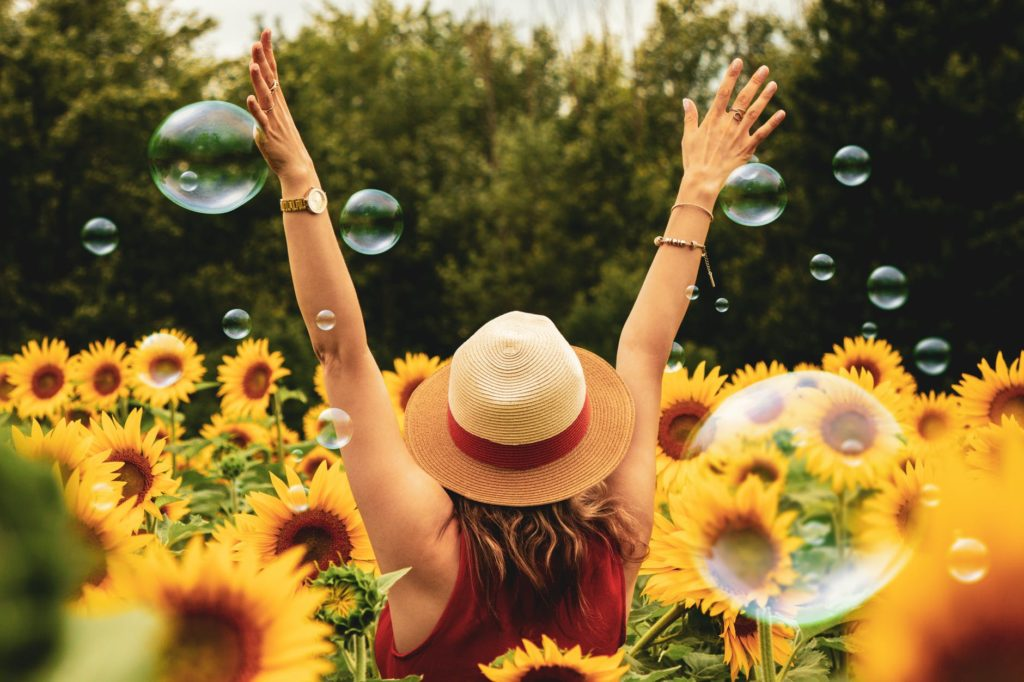 """Photo by Andre Furtado on <a href=""""https://www.pexels.com/photo/photography-of-woman-surrounded-by-sunflowers-1263986/"""" rel=""""nofollow"""">Pexels.com</a>"""