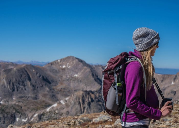 woman confidently hiking alone