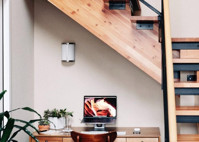 staircase with workspace underneath it